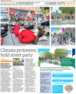 A woman in a red outfit sleeps on the floor of a shell gas station in London preotesting agasint climate change. Extinction Rebellion (XR) Islington protesting on Upper Street at the Shell Gas station. Photograph by Siorna Ashby, a portrait photographer in north London, Finsbury Park for the Islington Gazette