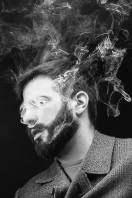 a black and white image of a man vaping from a portrait session in north London. Photograph by Siorna Ashby