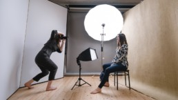 A London portrait photographer taking a London headshot photograph in a studio with wooden floors