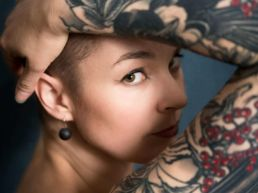 A woman with tattoo at a London photography studio