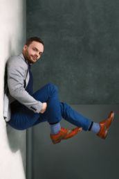 A man in a suit floating at a London photography studio
