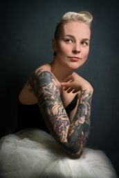 A woman with tattoo and blonde hair at a London photography studio