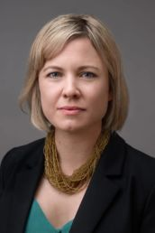 A London headshot photography photoshoot of a woman in a jacket and gold necklace