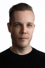 a male London headshot photo with white background and black t shirt