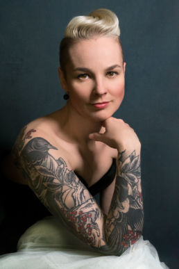 London Portrait Photographer of a woman with a bird tattoo and tulle